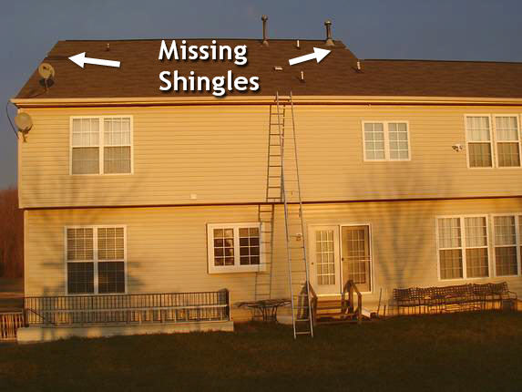 missing shingles on the rear of house
