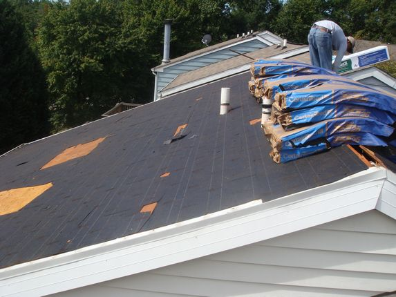Old roofing felt being removed